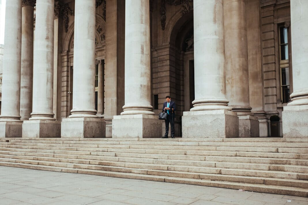 An individual getting information standing on steps outside